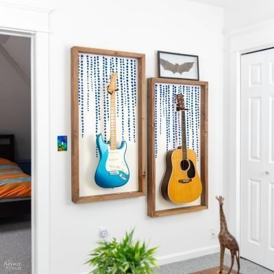 two guitars hanging in diy guitar display frames