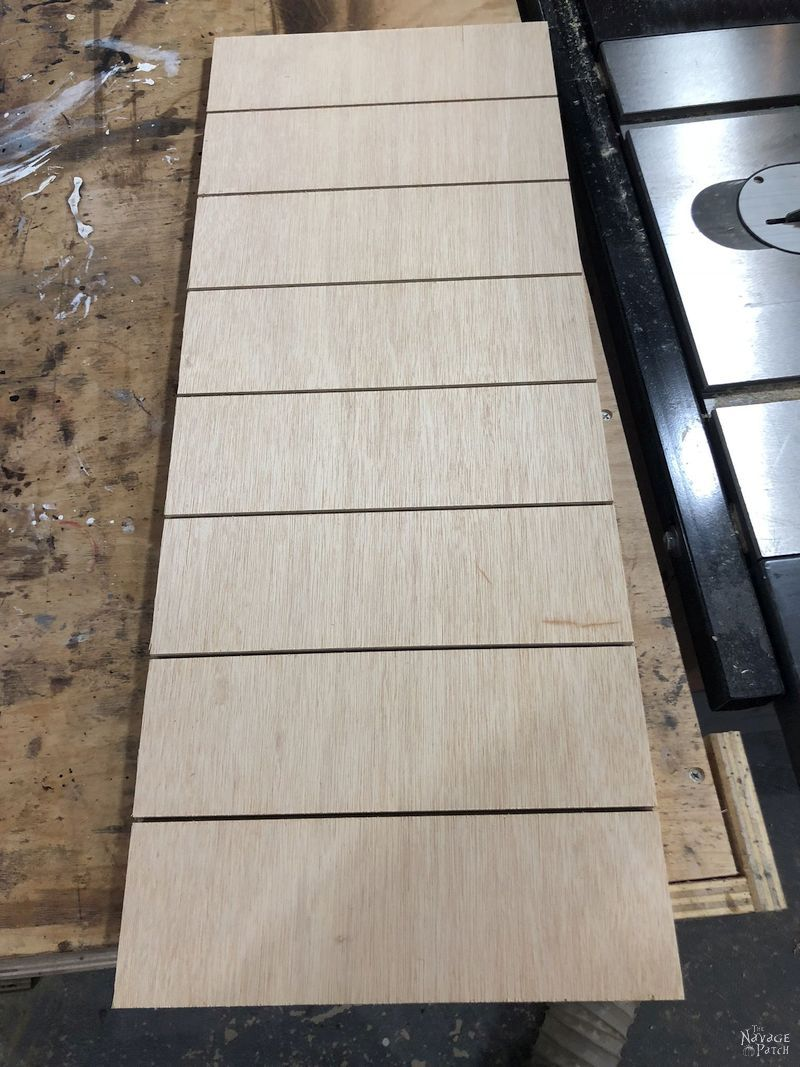 plywood for vertical chess board with grooves cut into it