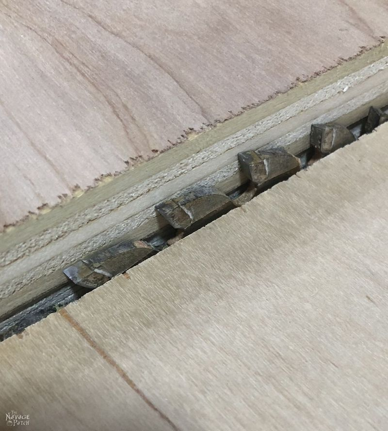 saw blade next to plywood