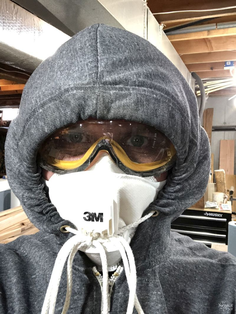 man in hoodie with goggles and face mask
