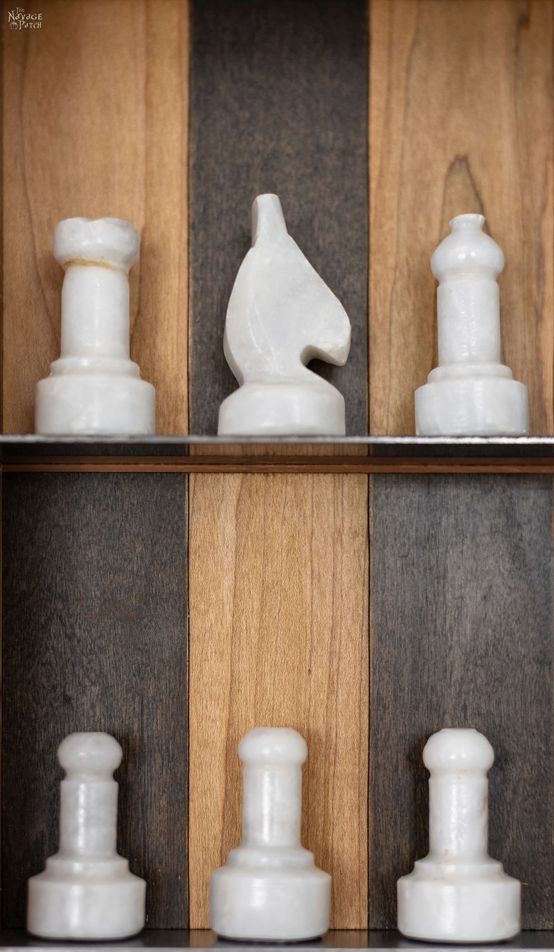 chess pieces on a vertical chess board
