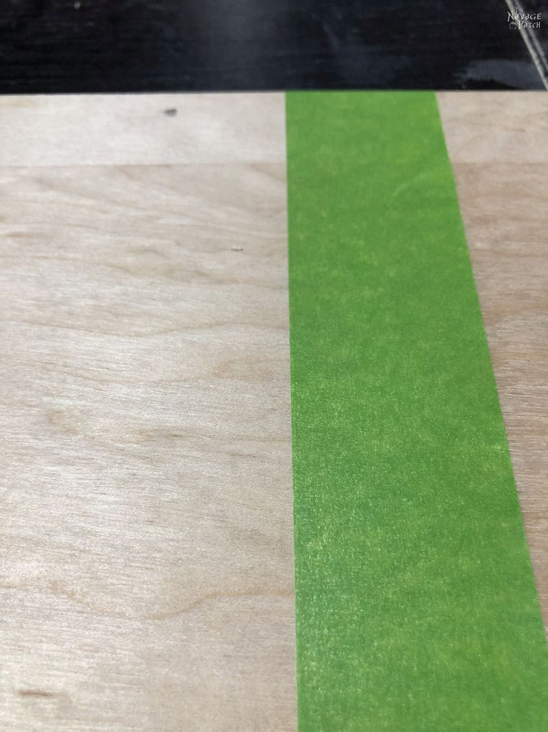green tape on plywood