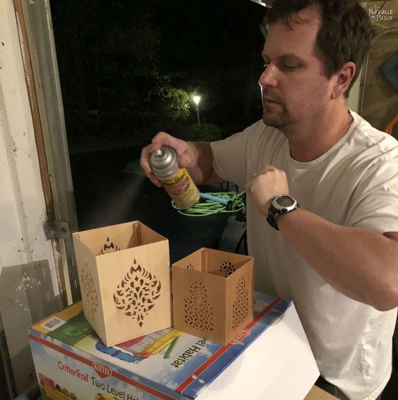 spraying shellac on DIY Moroccan Lanterns