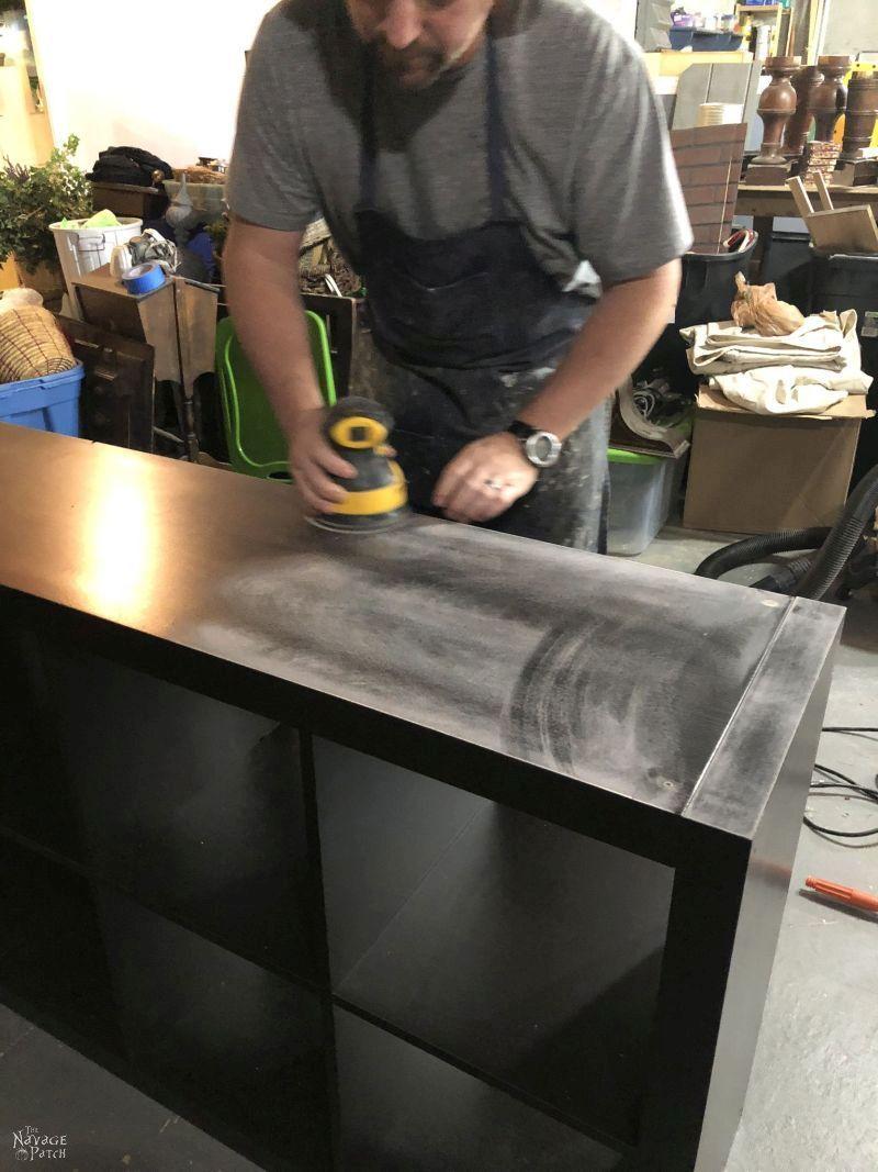 sanding an IKEA Kallax with a random orbital sander
