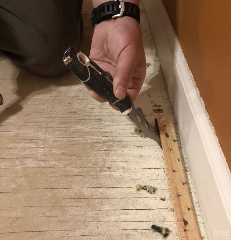 prying up a carpet tack strip