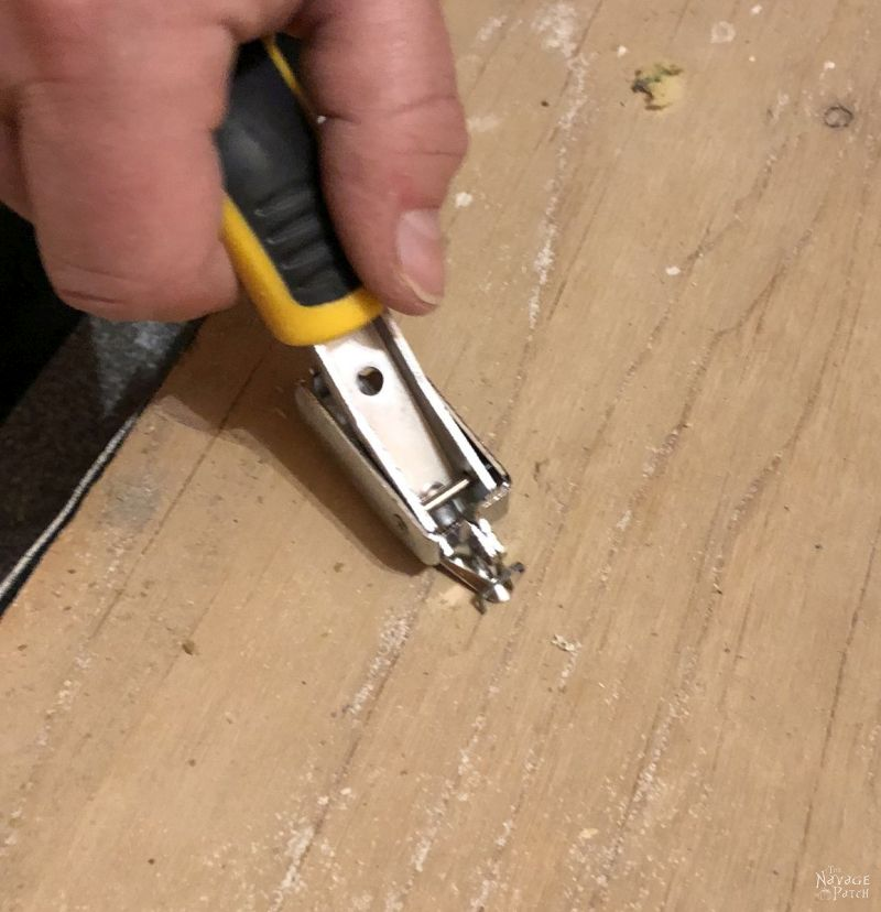 lifting carpet staples with a construction staple remover