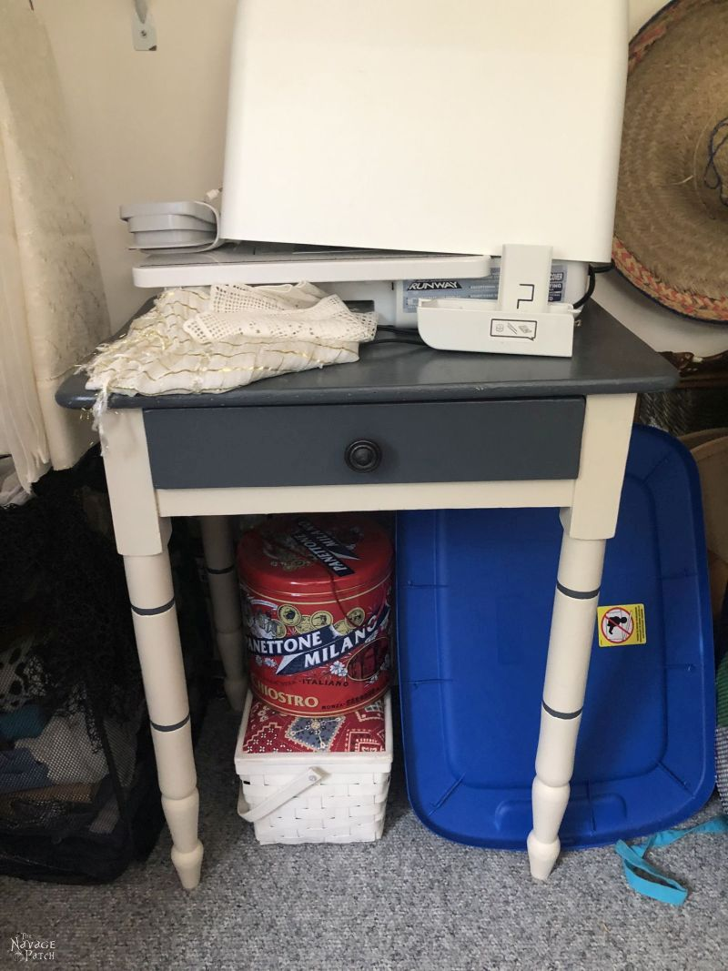 side table in a messy closet