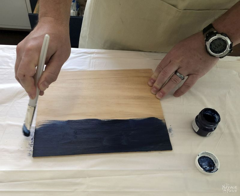 piece of pine getting painted blue