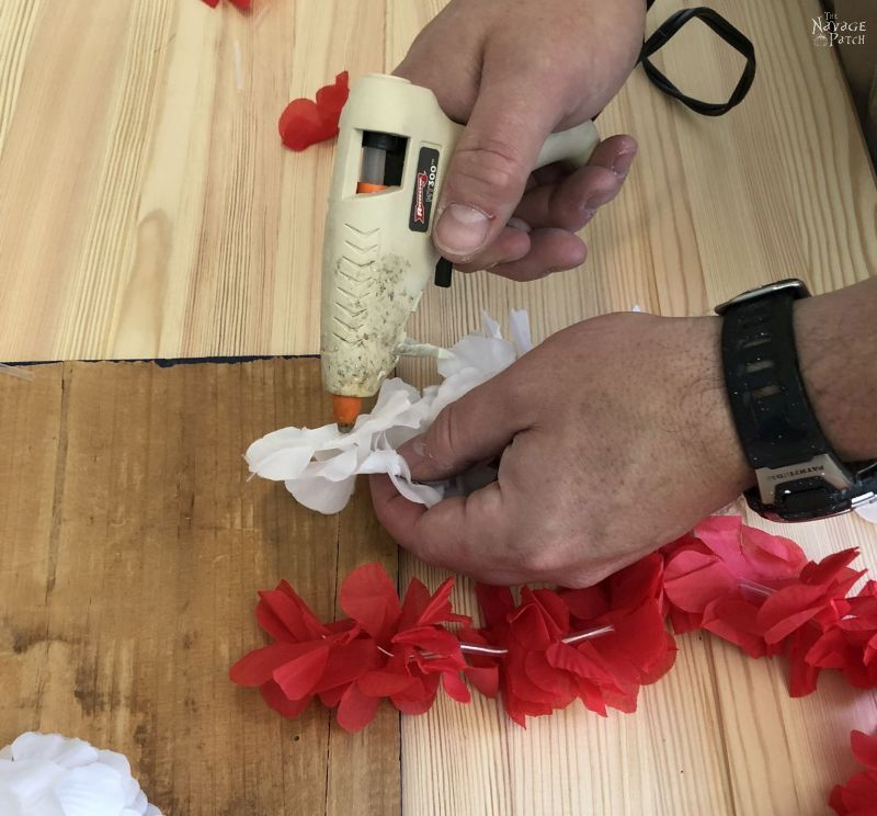 hot gluing a lei to a board