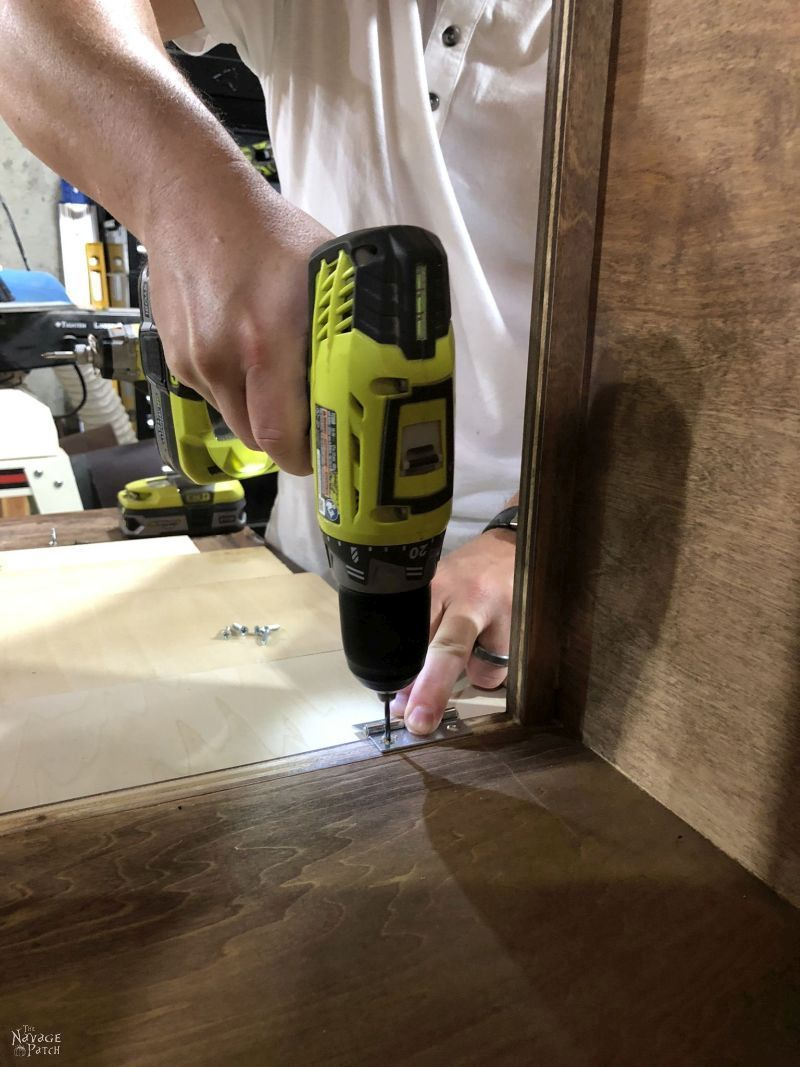 pre-drilling screw holes for hinges