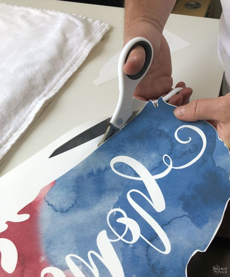 cutting out a heat transfer image with scissors