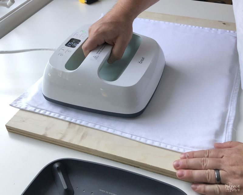 preheating a pillow cover with a cricut easypress 2