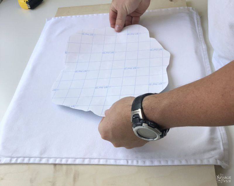 placing a design for heat transfer on a pillow cover