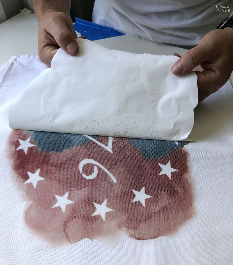 peeling a heat transfer paper from a diy patriotic pillow