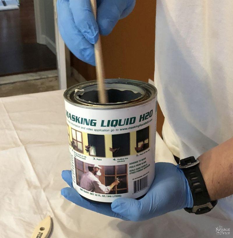 stirring a can of making liquid h2o