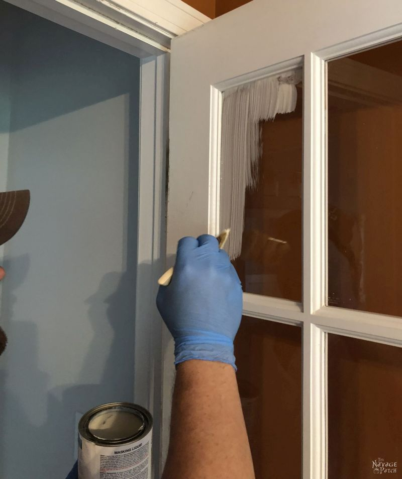 applying masking liquid to a french door to be painted