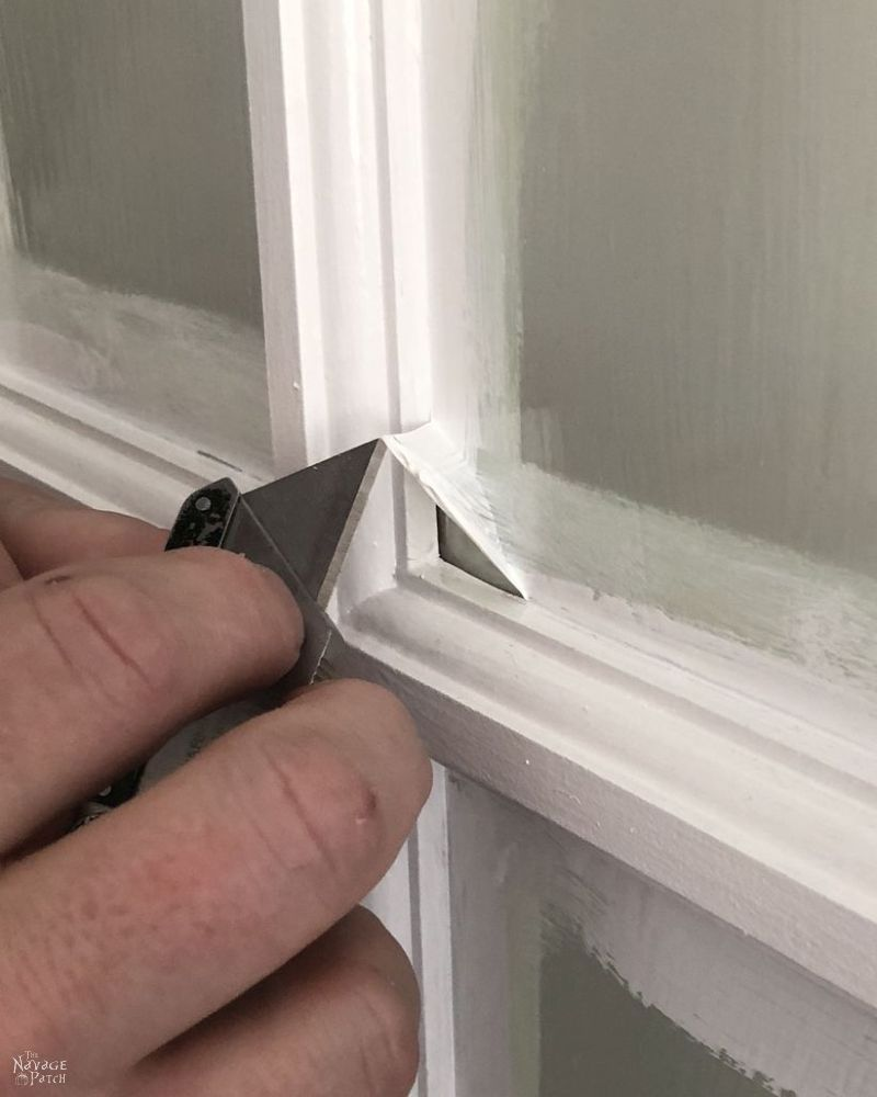 peeling the mask from a french door pane