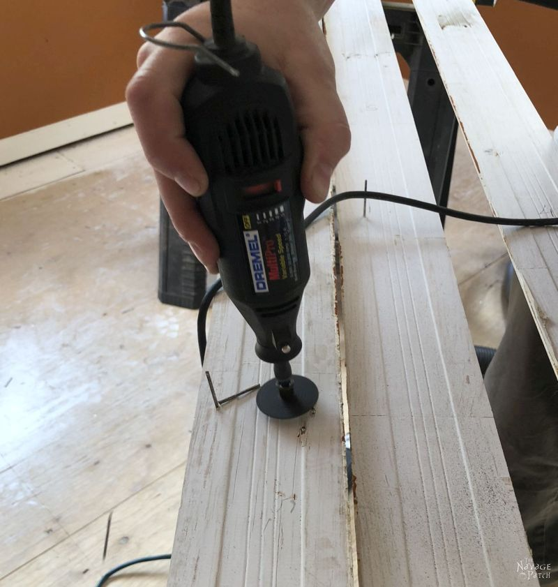cutting off baseboard nails with a Dremel tool