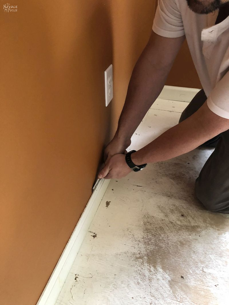 cutting caulk on baseboard