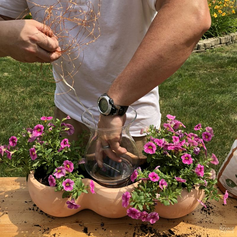 putting fairy lights into a clay pot planter