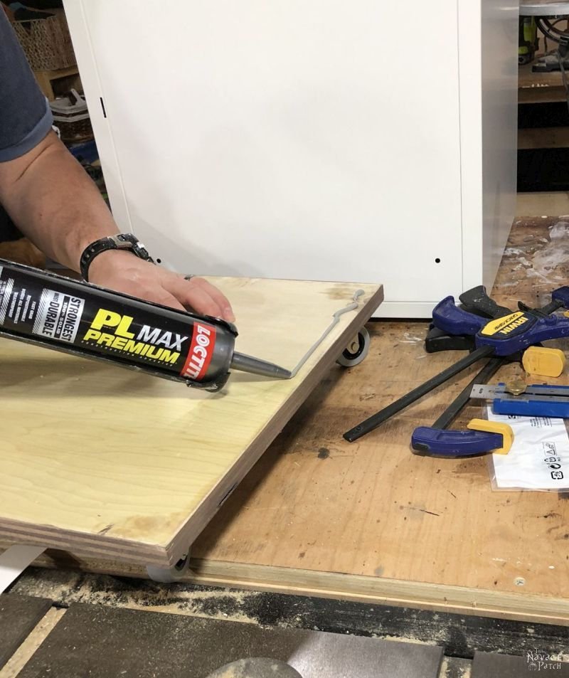 applying construction adhesive to plywood