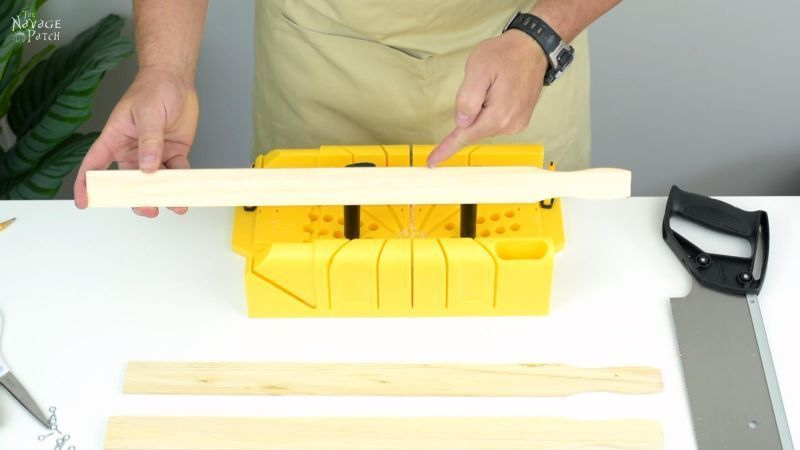 preparing to cut wood in a miter box