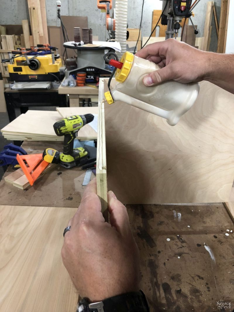 applying glue to a plywood edge
