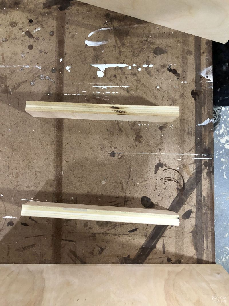 two pieces of plywood on a table