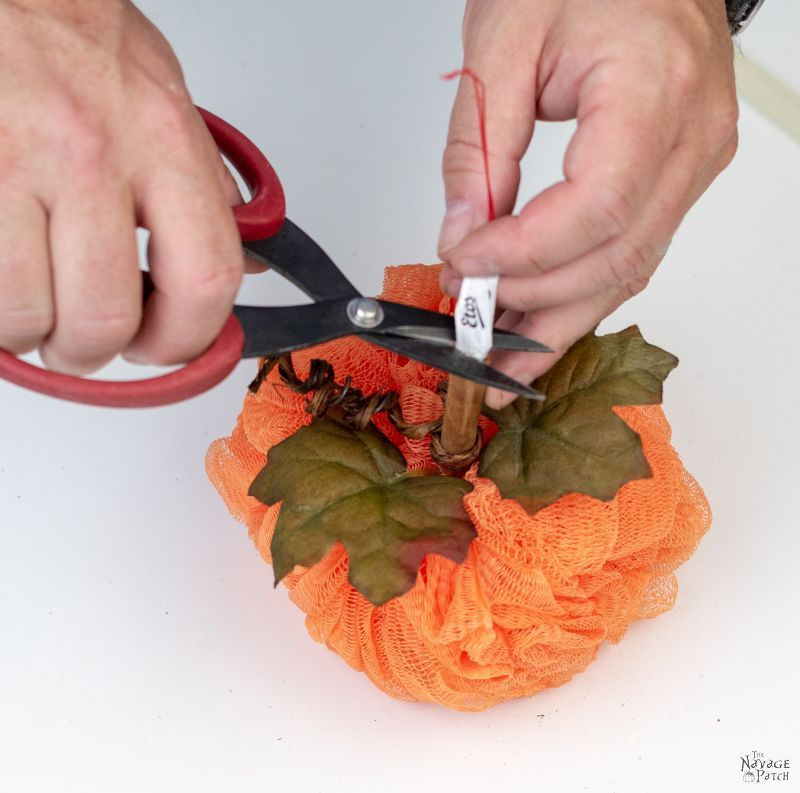 putting the stem on a shower pouf pumpkin