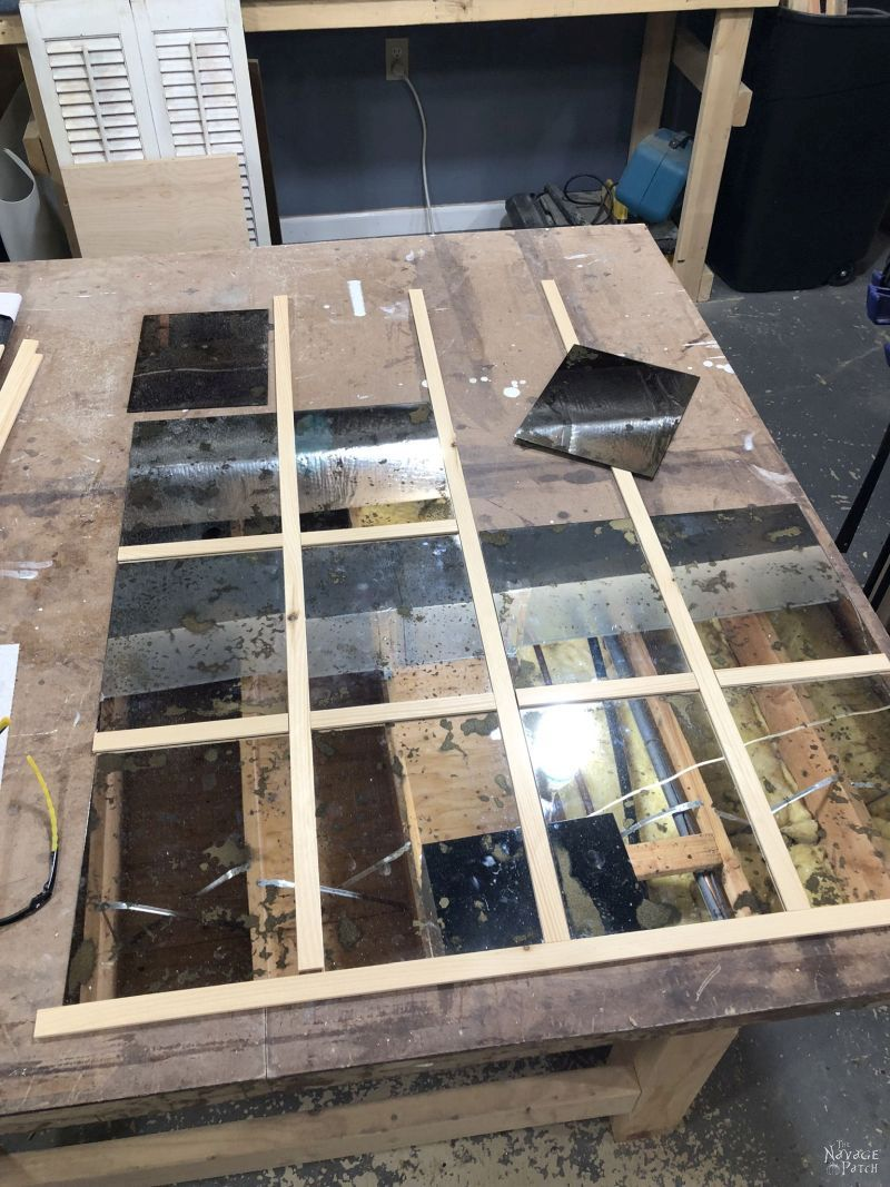 antiqued mirror panels on a table