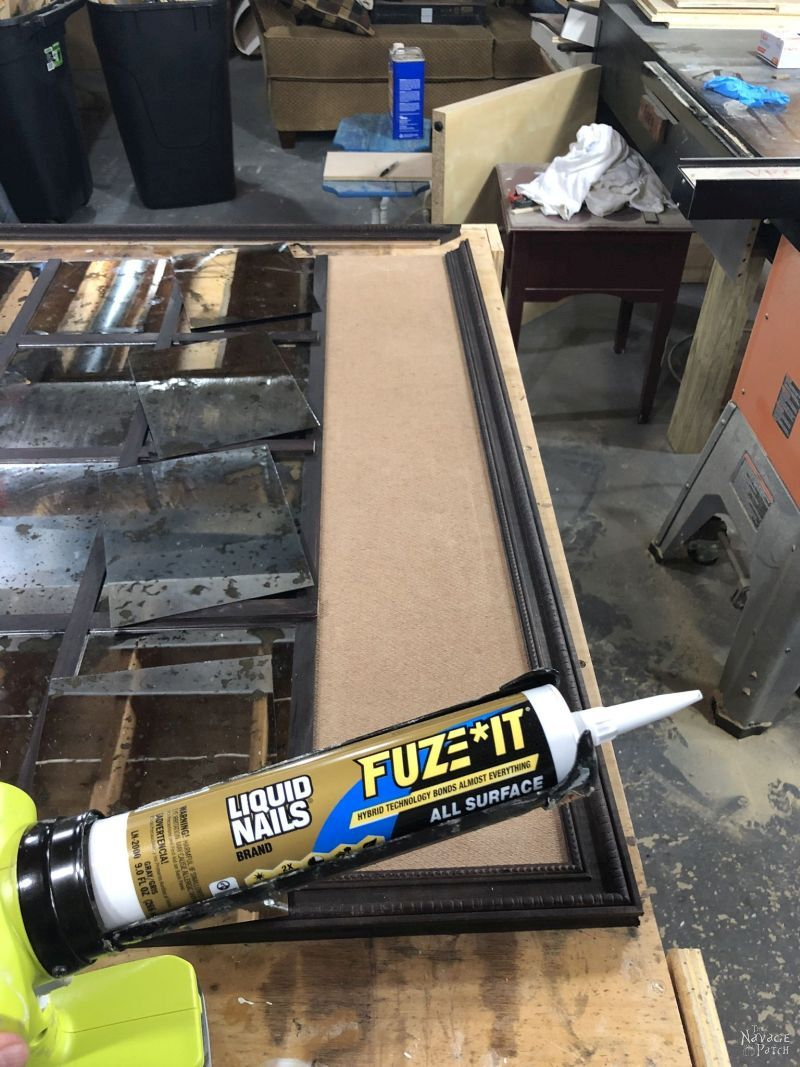 using construction adhesive to build a diy antiqued panel mirror