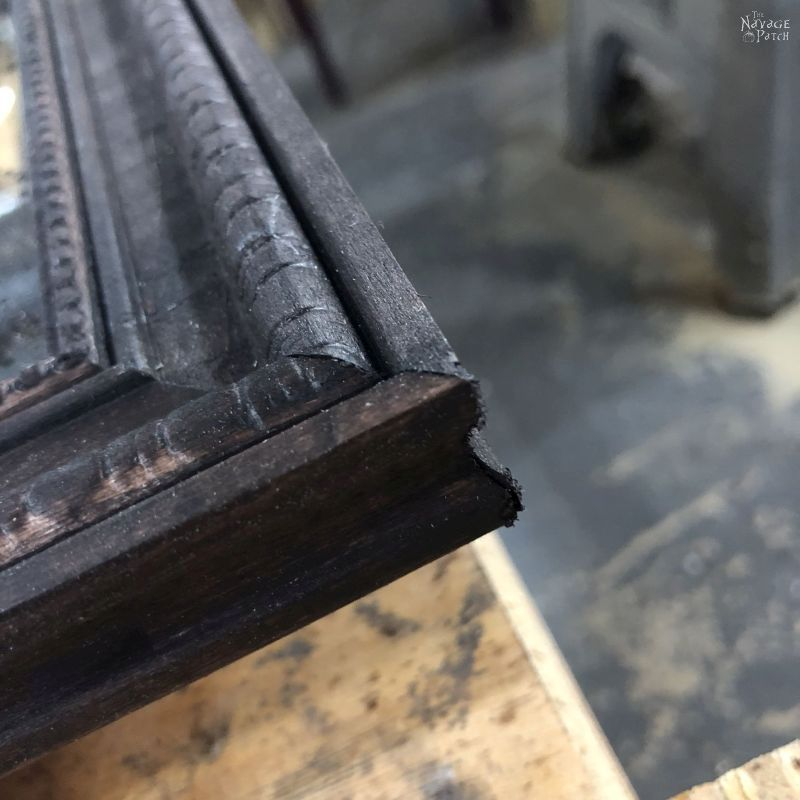 corner of a diy antiqued panel mirror