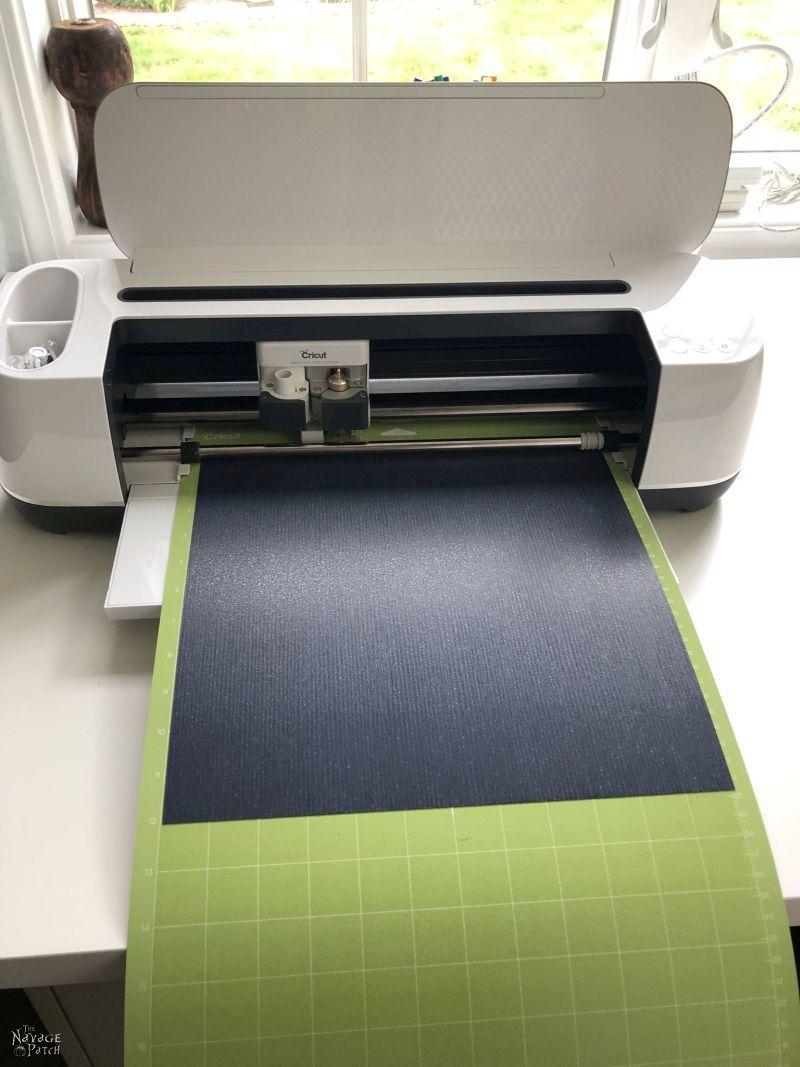 Cricut Maker cutting a design in heat transfer vinyl