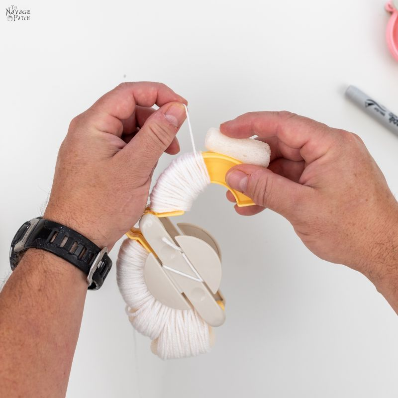 wrapping yarn around a pom pom maker