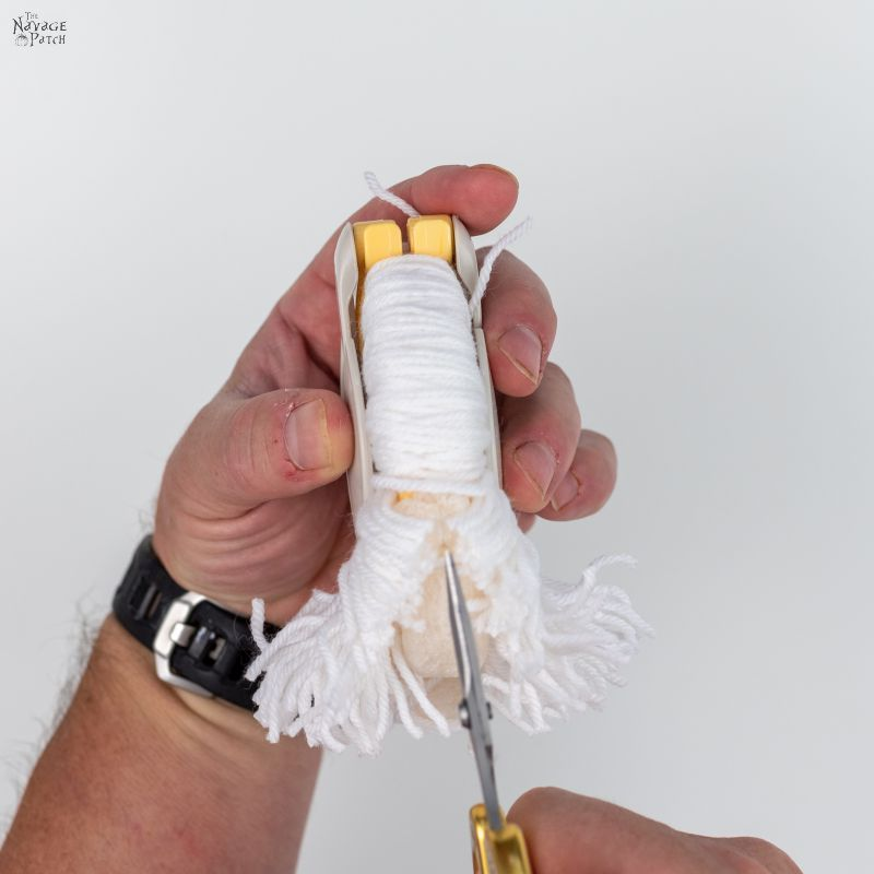 cutting yarn with scissors