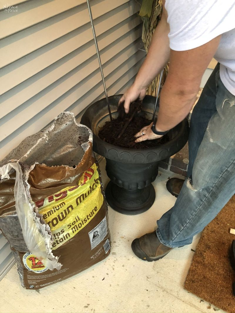 filling an urn with mulch