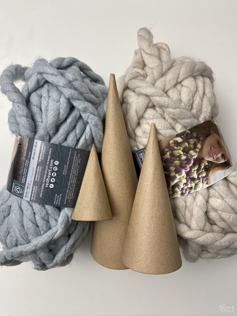 chunky yarn and paper mache cones on a table