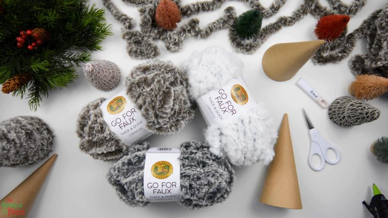 faux fur yarn and paper mache cones on a table