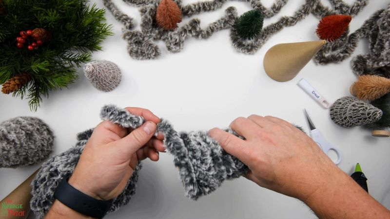 wrapping faux fur yarn around a paper mache cone