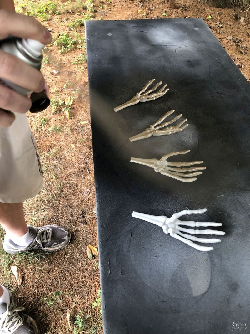 spray painting plastic skeleton arms