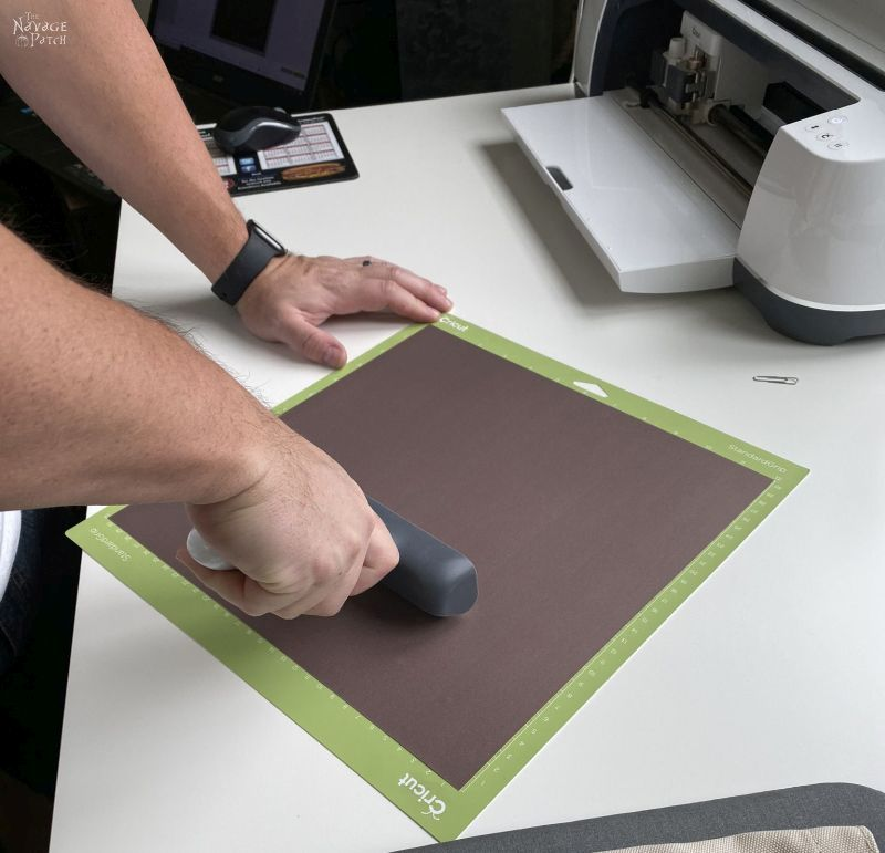 putting an infusible ink transfer sheet onto a mat