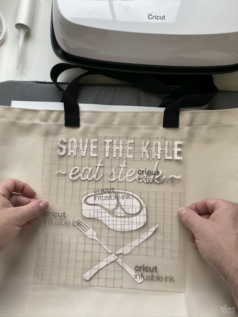 positioning an infusible ink transfer sheet on a tote bag
