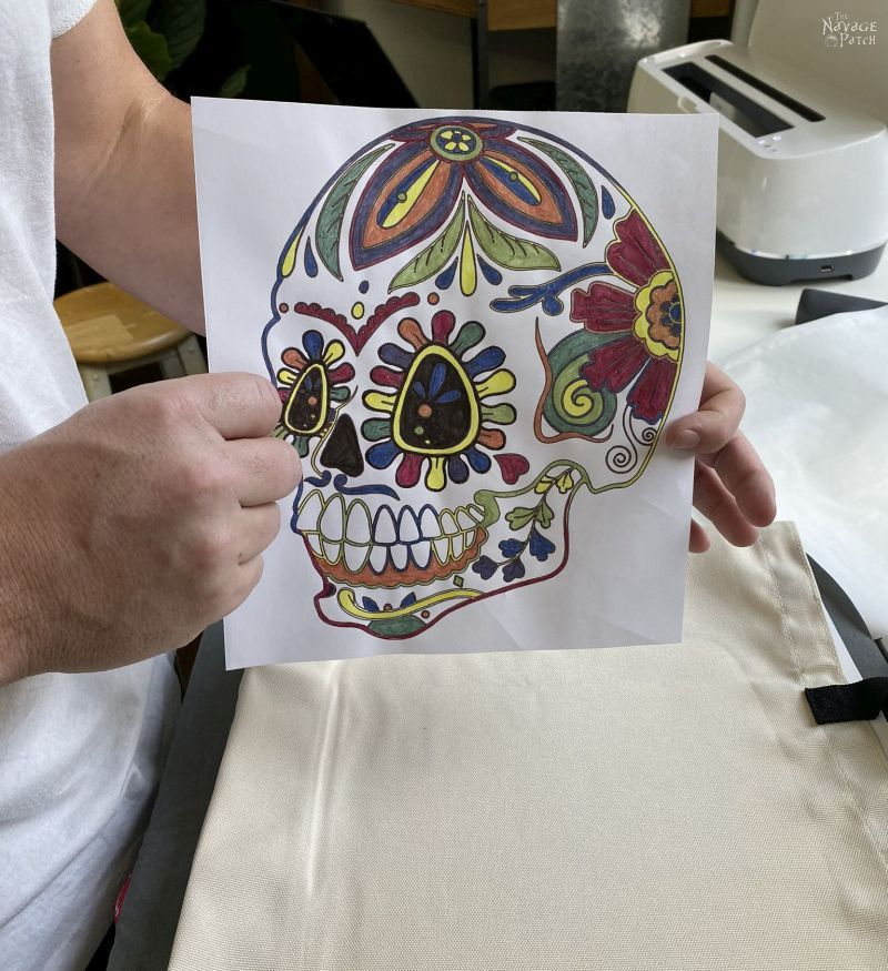 sugar skull colored with infusible ink markers ready for heat transfer onto a tote bag