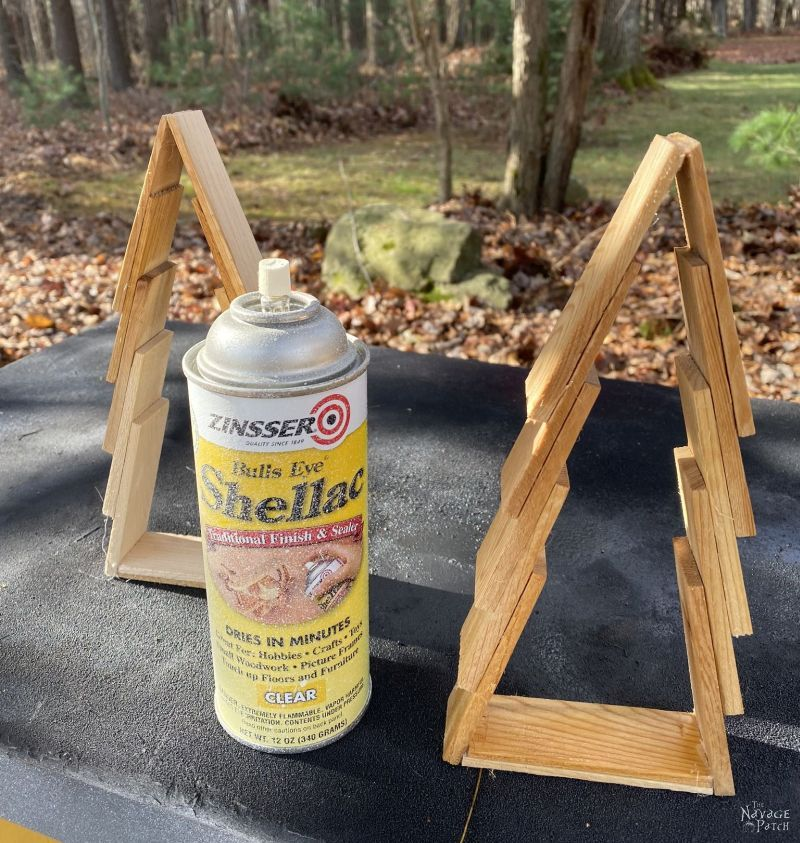 spraying wood shim trees with shellac