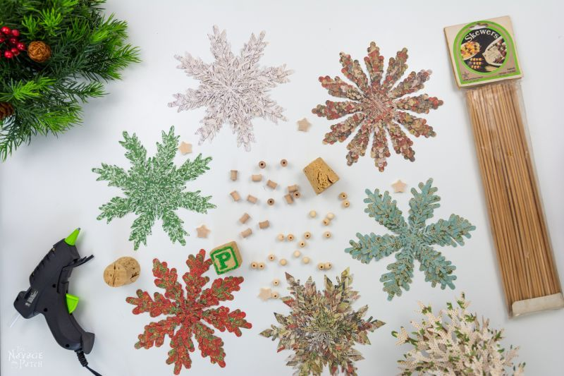christmas cardstock cut into snowflake patterns for trees