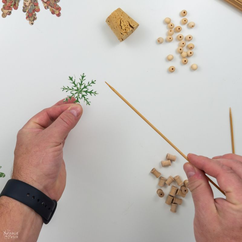 wooden skewer and paper snowflake