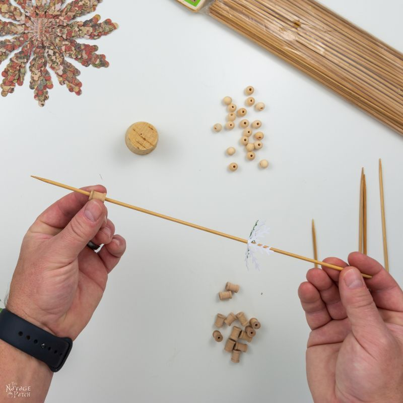 sliding a bead onto a skewer