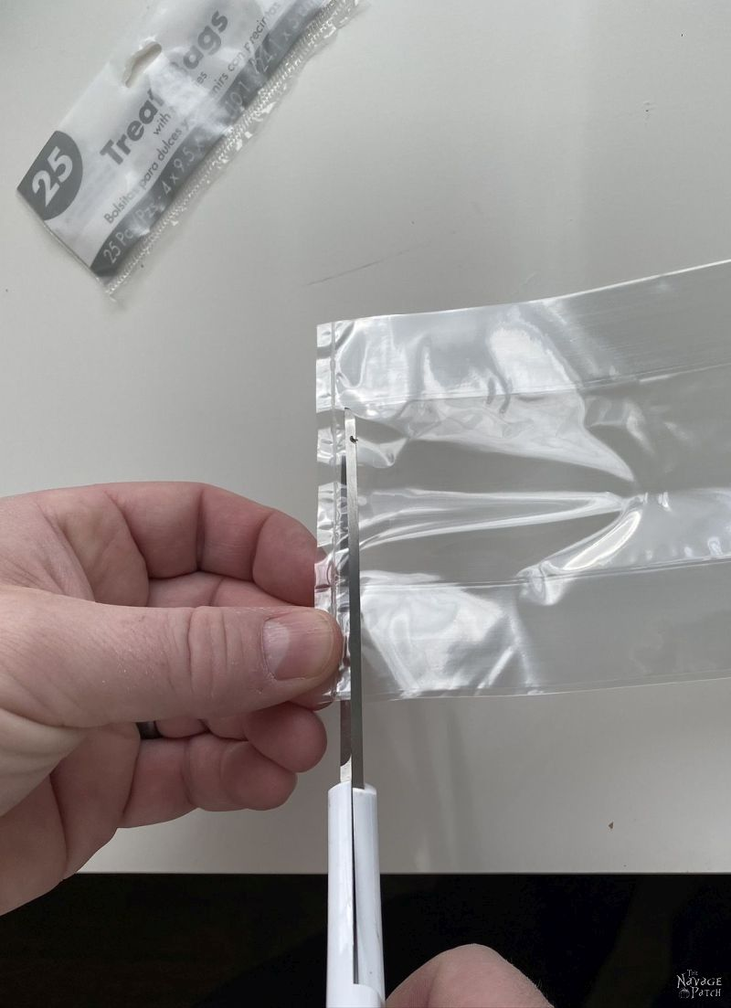 cutting the bottoms off cellophane treat bags