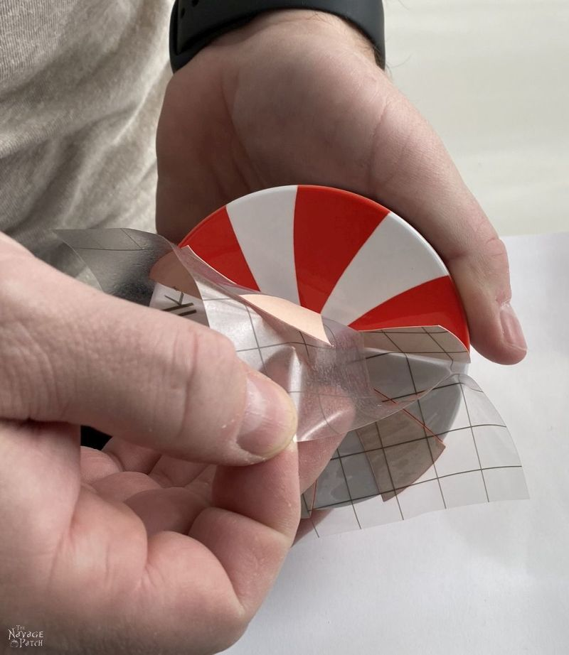 peeling the transfer sheet from a peppermint candy coaster