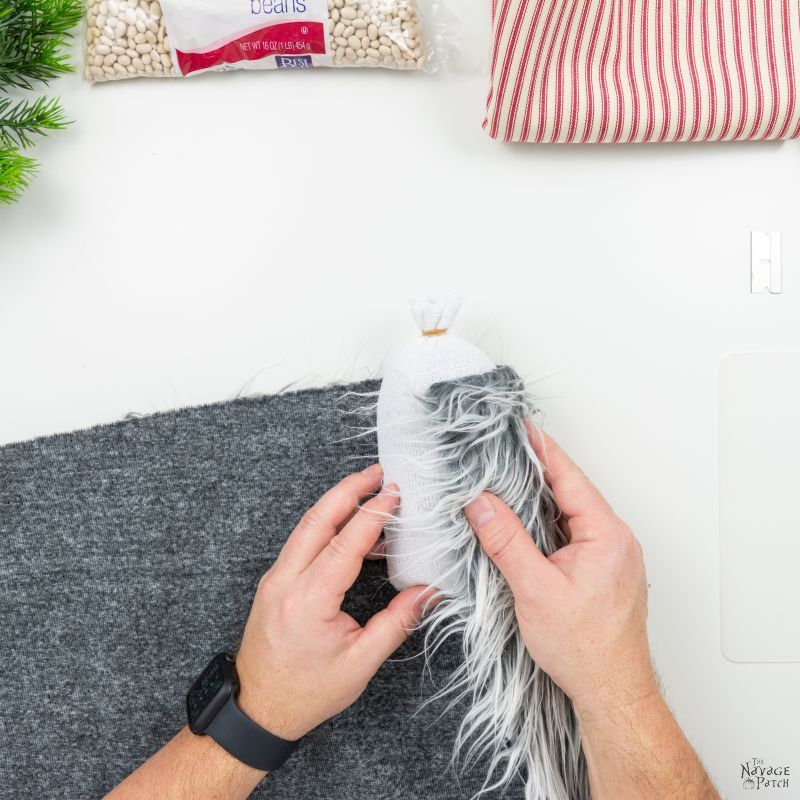 wrapping fur around a sock for diy christmas gnomes